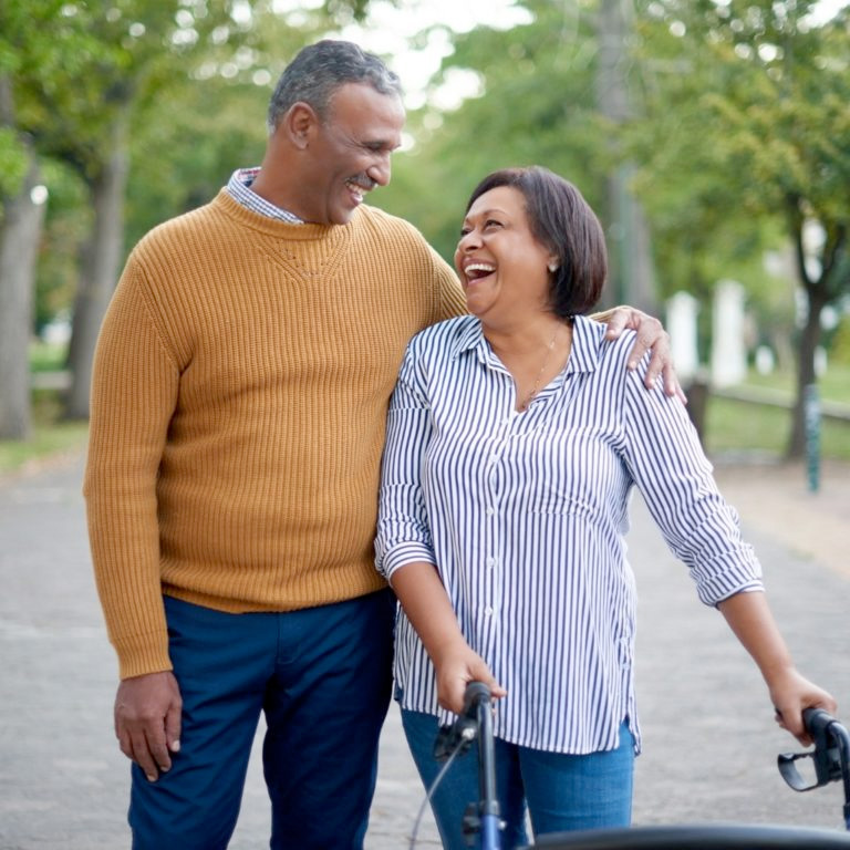 Image of Mature couple enjoying a walk outdoors